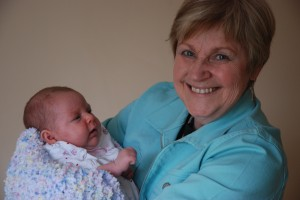 Gramma P holding a month-old Crazybaby